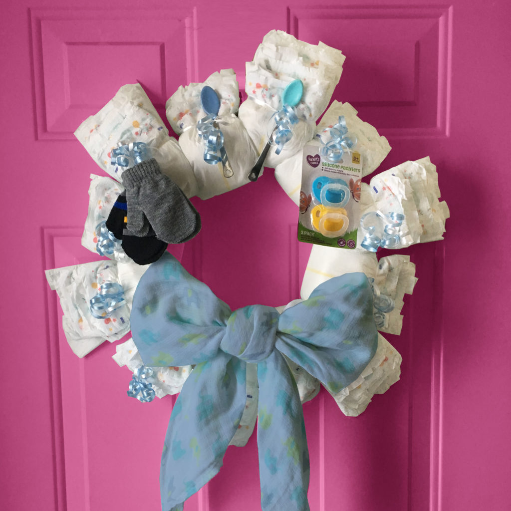 DIY diaper wreath on door